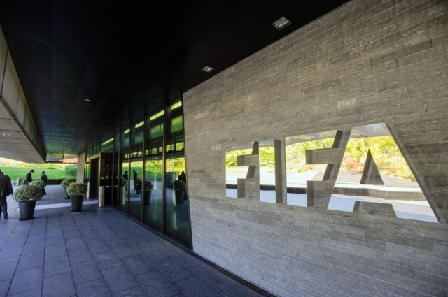 (FILES) This file photo taken on September 3, 2013 shows the logo of the FIFA (International Federation of Association Football) outside the organisation's headquarters in Zurich. Top FIFA officials were arrested early on May 27, 2015 by Swiss police acting on US corruption charges, The New York Times reported.    AFP PHOTO / FILES / SEBASTIEN BOZON