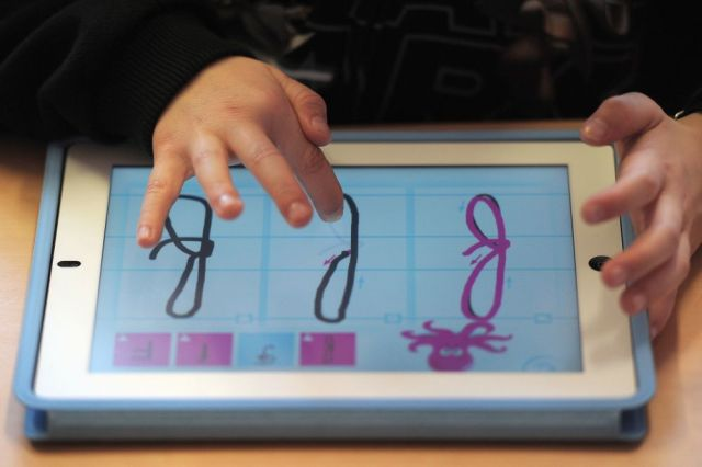 A nursery school pupil works with a tablet computer, on March 18, 2013 in Haguenau, northeastern France. AFP PHOTO / FREDERICK FLORIN
